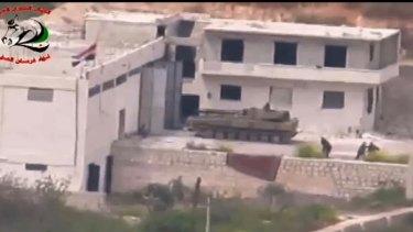 Footage supplied by the Free Syrian Army's Fursan al-Haq Brigade shows a Syrian tank near Ariha, in Syria's Idlib province, moments before a TOW missile strike.