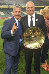 The whisperer: Bradley Charles Stubbs with Graham Arnold.
