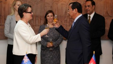 Australia's ambassador in Phnom Penh, Angela Corcoran, toasts the upgrading of ties with Cambodian's Minister of Foreign Affairs Prak Sokhonn.