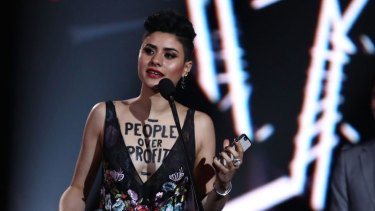 Montaigne accepts her ARIA for Breakthrough Artist with a political message painted on her chest.