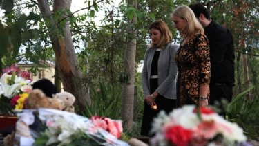 Minister for the Prevention of Domestic and Family Violence Shannon Fentiman and Parkinson Ward councillor Angela Owen-Taylor pay their respects at a candelight vigil for Queenie Xu in a park across the road from where she was stabbed to death in Parkinson.