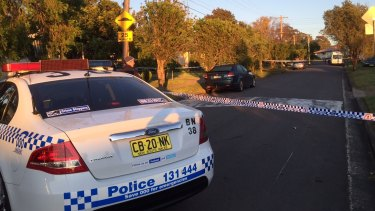 Police at the scene where a woman and her seven-year-old grandson were killed.