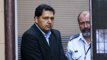 Adeel Khan leaves the NSW Supreme Court in a prison van.