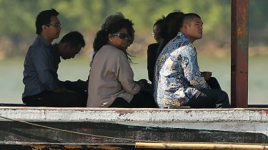 Raji Sukumaran, the mother of Myuran Sukumaran and Michael Chan, right, the brother of Andrew Chan among the families of both Bali Nine members on board a boat headed for to Nusakambangan for their first visit.