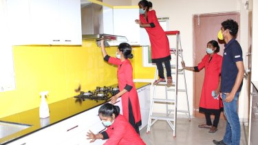Indian maids being trained by GDH Workforce, an agency in Hyderabad, on how to clean kitchens and bathrooms and how to use a vacuum cleaner.