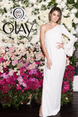 For the beauty launch lunch at The Butler in Potts Point, Campbell wore a Grecian style, white, flowing, floor-length Bec & Bridge dress.