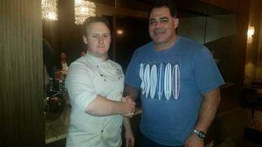 Mal Meninga is wished a happy birthday by Bacchus head chef Mark Penna before tonight's Origin series decider.