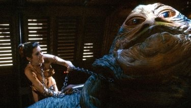 Princess Leia (Carrie Fisher) with Jabba the Hutt in Return of the Jedi (1983).