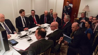 US President Donald Trump receives a briefing on the Syria military strike from his National Security team at Mar-a-Lago in Florida.