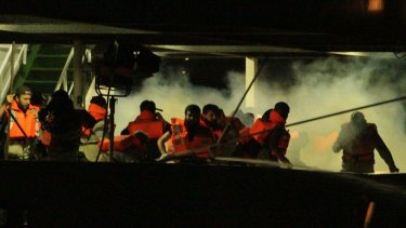 No investigation: Passengers on the Turkish ship the Mavi Marmara, surrounded by smoke from tear gas.