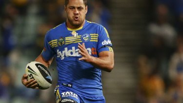 Star: Jarryd Hayne races away to score a try for Parramatta against Cronulla at Pirtek Stadium in 2014.