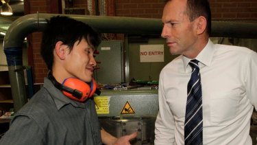 Then opposition leader Tony Abbott meeting Tuang Dong when he toured  Paragon Printing in 2011.