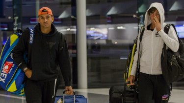 Plenty of baggage: Nick Kyrgios and Thanasi Kokkinakis arriving at Canberra airport in July.