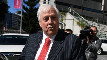 Clive Palmer leaves the Planning and Environment Court in Brisbane on Friday.