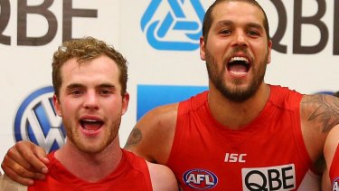 Tom Mitchell and Lance Franklin celebrate a Swans win.