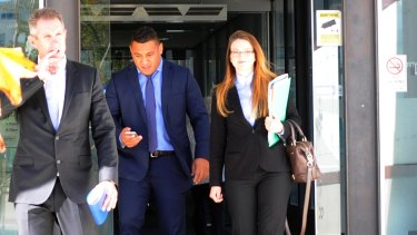 Axed: Canberra Raider Josh Papalii, centre, leaving the ACT Magistrates Court before his sacking from the Kangaroos.