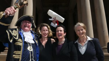 In better days: Town crier Graham Keating, Jess Miller, Sydney Lord Mayor Clover Moore and Professor Kerryn Phelps on the steps of Town Hall at the proclamation of the 2016 council.