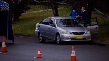 Police have closed two lanes of Griffiths Road in Lambton after finding a body in a car.