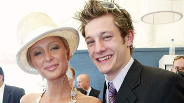 """Rob 'Millsy' Mills, best known for Australian Idol and his romance with hotel heiress Paris Hilton, has opened up about drug use and being """"a little bit gay"""". The unlikely pair at Melbourne Cup in 2003."""