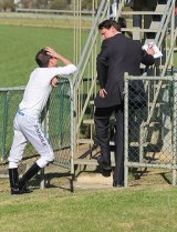Jockey Danny Nikolic speaks with Terry Bailey at Seymour Races in September 2012.