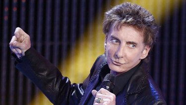 Barry Manilow, on stage in 2012, has reportedly married his long-term boyfriend Garry Kief.