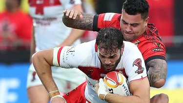 Pacific power: Andrew Fifita tackles Alex Walmsley at Mount Smart Stadium.