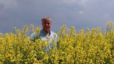 Ballarat man Lawrence Richmond standing in a Ukraine canola crop.