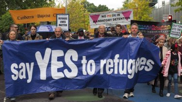Church leaders and others take part in the pro-refugee rally on Palm Sunday.