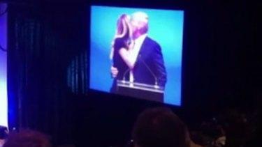 Jennifer Hawkins appears to turn her cheek as Donald Trump goes to kiss her.