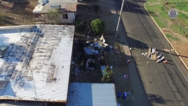 An image shot from a drone shows the remains of a caravan that exploded in the Mount Isa suburb of Mornington, killing Charlie Hinder, 39, along with his children Nyobi, 7, and River, 4.