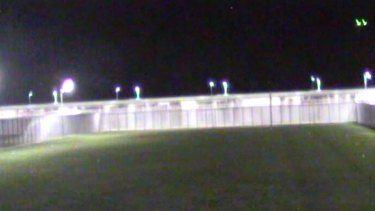 CCTV at Lithgow Correctional Centre reveals the green glow of a drone (top right corner), as it landed in the prison yard.