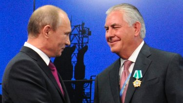 Russian President Vladimir Putin (left) presents ExxonMobil CEO Rex Tillerson with a Russian medal at an award ceremony in 2012.