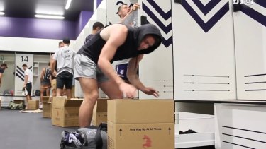 Players re-pack their lockers as they settle in to their new home.