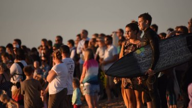 Friends and family of Laeticia Brouwer gather for a tribute paddle-out at Singleton beach.