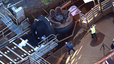 The scene at the Thunder Rapids ride after the accident.