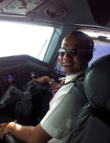 Tommy Abu Alfatih in the cockpit of a plane.