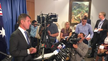 Premier Mike Baird at Tuesday's media conference announcing the reversal.