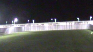 The drone completes its landing in the prison yard (right).