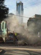 Dust filled the streets as the wall came crashing down.