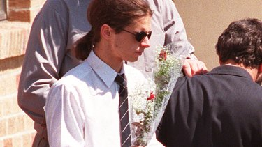 Matthew De Gruchy at the funeral of his mother, brother and sister in 1996.