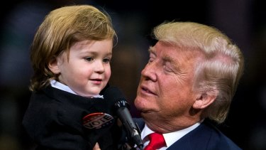 Donald Trump holds two-year-old Hunter Tirpak, who is dressed as Trump, during a rally in Pennsylvania last week.