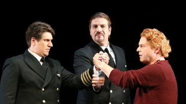 Hagen (Daniel Sumegi) watches on as Gunther (Luke Gabbedy) and Siegfried (Stefan Vinke) take a blood oath.