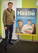 Canning MP Andrew Hastie says he won't remove photos of himself in uniform from his federal election campaign material.