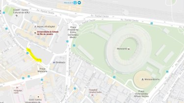 A man was found dead outside Rio's state university (yellow) near Maracana Stadium, the site of the Rio Olympics Opening Ceremony.