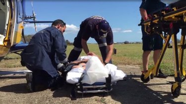 A man believed to be in his 40s was taken to Bundaberg Base Hospital  after a pod of whales capsized his tinnie.