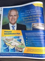 An advertisement in a local newspaper trumpets the Turnbull government's $20 million investment at the HMAS Platypus site.