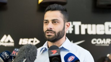 AFL diversity officer Ali Fahour reads a statement after attacking another player.