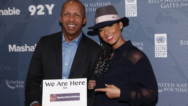 """Bryan Stevenson, founder of the Equal Justice Initiative which is campaigning against sentencing children to life without parole with singer songwriter Alicia Keys whose """"We Are Here"""" group are supporting their work."""