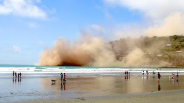 Dust clouds rise in Sumner following the collapse of a cliff during Sunday's large earthquake.