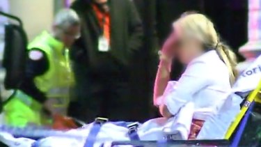 A woman attended to by paramedics near King Street nightclub Inflation.